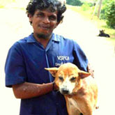 VSPCA worker with rescued dog